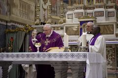 Bishop officiating Communion Stock Images