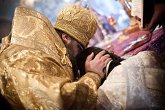 The Bishop prays with a monk during ordination. Orthodox liturgy with bishop Mercury in High Monastery of St Peter in Moscow on March 14, 2010 in Moscow Stock Image