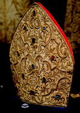 Bishop's Hat. A mitre or miter is a bishop's hat. This gem-studded one is on display in the Porto, Portugal, Cathedral Royalty Free Stock Photography