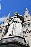 Bishop`s moniument. Bishop`s monument on the background of the cathedral of Armagh. Grey monument and Cathedral building and blue sky. An interesting a game of Royalty Free Stock Images