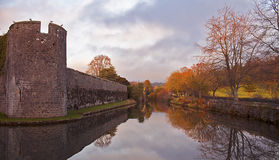 Bishop`s Palace Moat in Autumn. In Wells, Somerset. This has been the home of the Bishops of the Diocese of Bath and Wells for 800 years. The moat is famous for Stock Photos