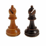 Bishops. A white and black chess bishop isolated on white stock photo