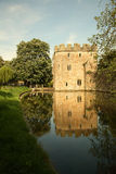 The bishops palace gatehouse, Wells. The Bishops palace gate house and moat with reflection Stock Photo