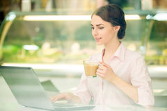 Bisinesswoman in cafe Stock Images