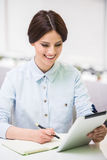 Bisinesswoman with tablet Stock Images