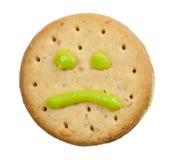 Biskuit mit traurigem Gesicht Stockfotos