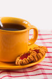 Biskuite mit Tasse Tee Stockbilder