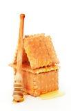 Biskuithaus mit Honig Stockfoto