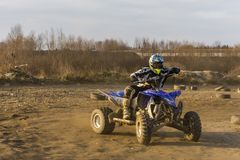 ATV Rider in the race at sunset. Biskupice Radlowskie, Poland - January 14, 2018: ATV Rider in the race at sunset Stock Photography