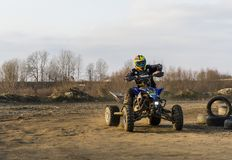 Riding a quad bike on the off-road. Biskupice Radlowskie, Poland - January 14, 2018: Riding a quad bike on the off-road Royalty Free Stock Image
