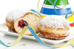 Bismarck donuts and party decoration Royalty Free Stock Photos