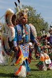 A dancer of the 49th annual United Tribes Pow Wow in blue. BISMARK, NORTH DAKOTA, September 8, 2018 : A dancer of the 49th annual United Tribes Pow Wow, one stock images