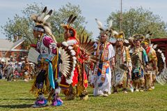 Dancers at the Grand Entry of 49th annual United Tribes Pow Wow. BISMARK, NORTH DAKOTA, September 8, 2018 : 49th annual United Tribes Pow Wow, one of largest stock photography