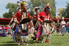 Red dancers at the 49th annual United Tribes Pow Wow. BISMARK, NORTH DAKOTA, September 8, 2018 : 49th annual United Tribes Pow Wow, one of largest outdoor event royalty free stock photography