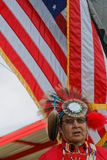 Flag and an old man at the 49th annual United Tribes Pow Wow. BISMARK, NORTH DAKOTA, September 8, 2018 : 49th annual United Tribes Pow Wow, one of largest royalty free stock image