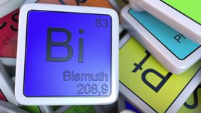 Bismuth Bi block on the pile of periodic table of the chemical elements blocks. 3D rendering Stock Photos