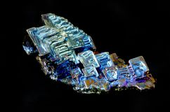 Bismuth. Crystal showing its regular rectangular structure. isolated on black Royalty Free Stock Photography