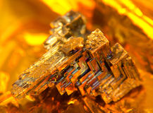Bismuth crystal. A multicolored Bismuth crystal, warm illuminated in golden back Royalty Free Stock Images