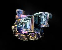 Bismuth Crystal. Structure of a bismuth crystal showing the regular structure; focus stacking on black Royalty Free Stock Photo