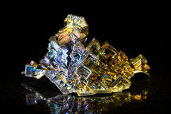 Bismuth in front of black Stock Photography