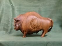 Bison, sculpture of wood Karagach royalty free stock images
