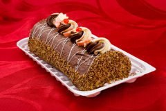 Bisquit cake. View of a chocolate cake on red background Stock Photography