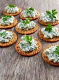 Bisquit cracker appetizers with cottage chees and parsley topping.  Royalty Free Stock Image