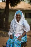 Portrait of a woman wearing a traditional dress with veil, at the Missira neighborhood in the city of Bissau. Bissau, Republic of Guinea-Bissau - February 6 royalty free stock image