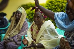 Group of women singing traditional songs at a community meeting in the city of Bissau, Guinea-Bissau. Bissau, Republic of Guinea-Bissau - January 31, 2018: Group Royalty Free Stock Images