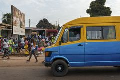 Street scene in the city of Bissau with a mini bus toca toca and people at the Bandim Market, in Guinea-Bissau,. Bissau, Republic of Guinea-Bissau - January 28 Royalty Free Stock Photos