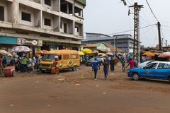 Street scene in the city of Bissau with people at the Bandim Market, in Guinea-Bissau, West Africa stock photography