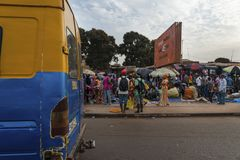 Street scene in the city of Bissau with the back of a public bus toca toca and people at the Bandim Market, in Guinea-Bissau. Bissau, Republic of Guinea-Bissau Stock Photos