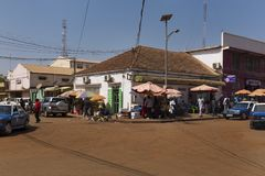 Street scene in the city of Bissau with people vendors selling vegetables and fish, in Guinea-Bissau. Stock Photos