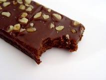 Bissen vom Schokoladenkuchen lizenzfreie stockfotos