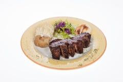 Bistecca arrostita con le patate cotte a vapore Immagine Stock