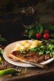 Bistecca cotta con le patate Fotografia Stock