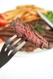 Bistecca cotta sulla forcella Fotografia Stock
