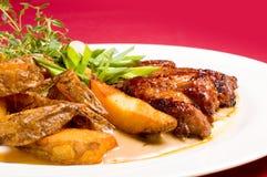 Bistecca del porco con le patate cotte Immagine Stock