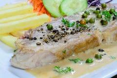Bistecca della carne di maiale con la salsa di pepe Fotografia Stock Libera da Diritti