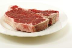 Bistecca di bistecca con l'osso grezza Immagini Stock Libere da Diritti
