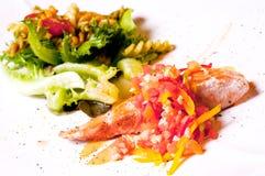 Bistecca di color salmone su priorità bassa bianca fotografia stock