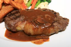 Bistecca di lombata in sugo Fotografie Stock