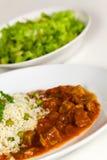 Bistecca di porco, cuocere-con insalata delle patate Fotografie Stock Libere da Diritti