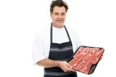 Bistecca di presentazione del macellaio Fotografia Stock