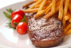 Bistecca e fritture Fotografia Stock