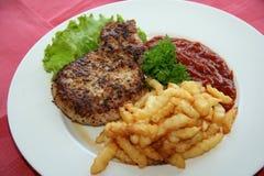 Bistecca e patata Fotografia Stock