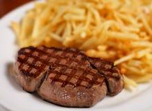Bistecca e patata fritta Fotografia Stock Libera da Diritti