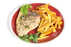 Bistecca e patatine fritte di pesce spada Immagini Stock