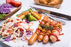Bistecca e salsiccie Fotografia Stock Libera da Diritti