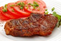Bistecca e verdure cotte Fotografie Stock